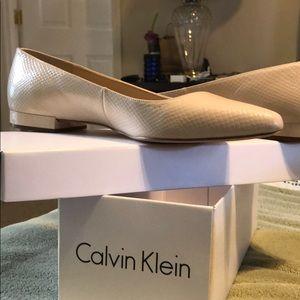 Calvin Klein nude snakeskin flats